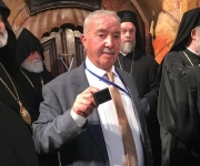 Mr. Wajeeh Nuseibeh, holding the seal to Christ's Tomb in the Church of the Holy Sepulcher, on the eve of Orthodox Easter and the Holy Fire.
