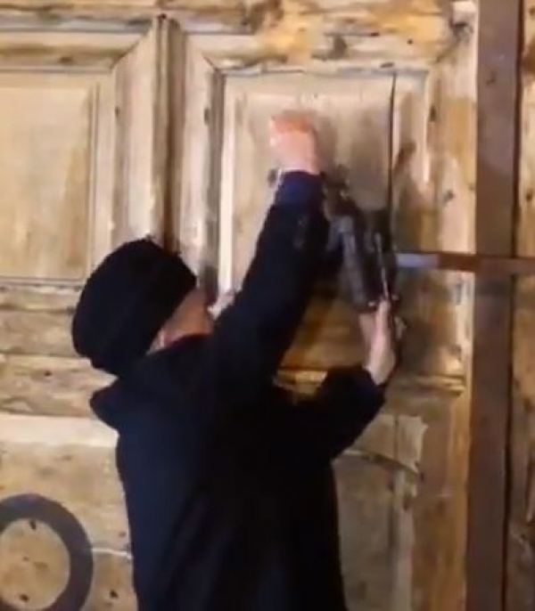 Mr.. Wajeeh Nuseibeh re-opening the gates of the Church of the Holy Sepulcher on February 28th, following three days of protests  against Israeli Policies to impose property Tax on the Church.